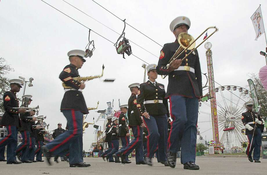 The Marine Band San Diego marches during Armed Forces Day at the Houston Livestock Show and Rodeo Carnival Wednesday, March 5, 2014, in Houston. Photo: James Nielsen, Houston Chronicle / © 2014  Houston Chronicle