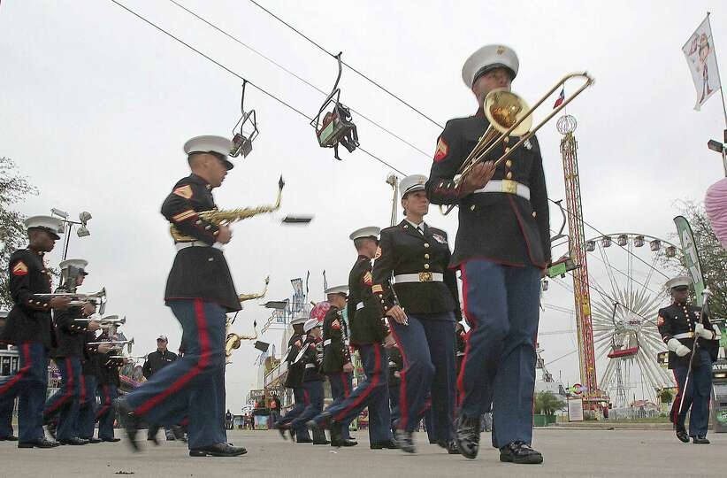 The Marine Band San Diego marches during Armed Forces Day at the Houston Livestock Show and Rodeo Ca