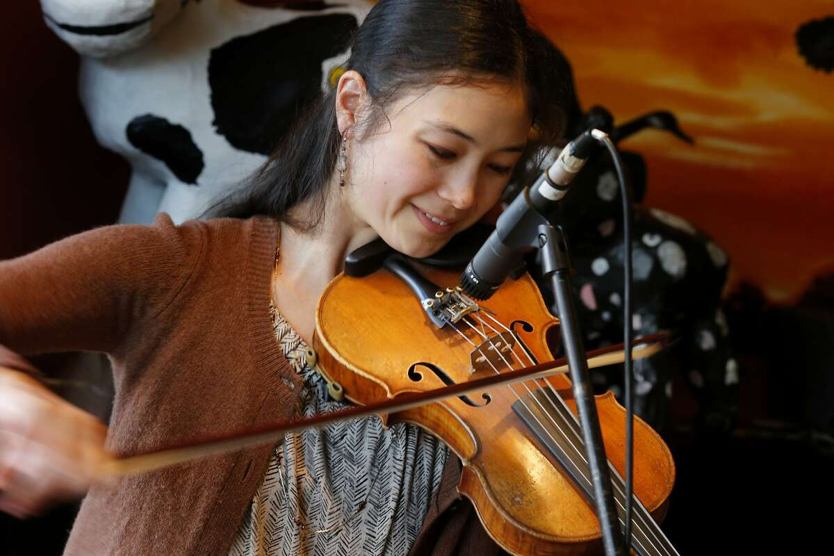Annie Staninec smiles to herself during a song performed Thursday February 13, 2014 in Berkeley, Calif. Prominent Bay Area fiddler Annie Staninec plays with Jimbo Trout and the Fish People at Cheese Board Pizza on Shattuck Avenue.