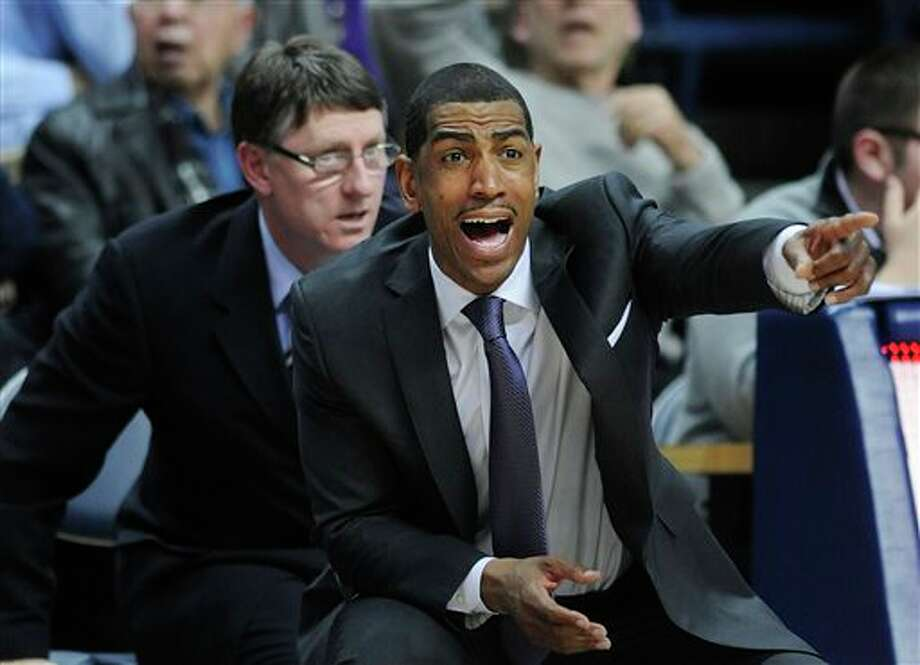 Connecticut  coach Kevin Ollie gestures during the second half of Connecticut's  69-63 victory over Rutgers in an NCAA college basketball game in Storrs,  Conn., Wednesday, March 5, 2014. (AP Photo/Fred Beckham)