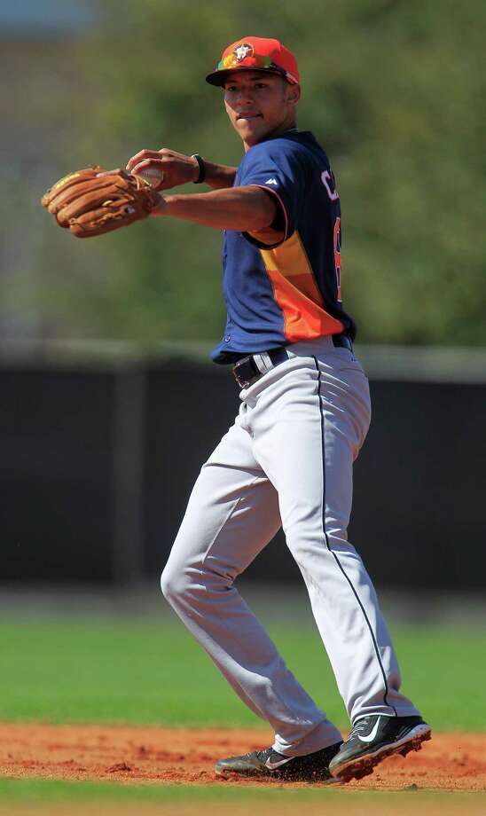 While 19-year-old shortstop prospect Carlos Correa has the build of a major leaguer, he's bound for the minors. Photo: Karen Warren, Staff / © 2013 Houston Chronicle