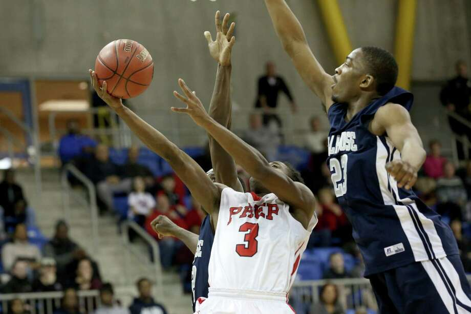 Fairfield Prep's # 3 Keith Pettway drives to the basket through two Hillhouse High School defenders during Wednesday evening SCC Championships at Quinnipiac University's TD Bank Sports Center. Prep would win 56-52. Photo: Mike Ross / Mike Ross Connecticut Post freelance -www.mikerossphoto.com