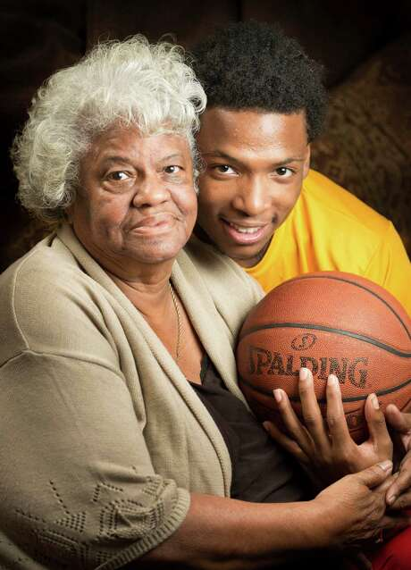 With his mom in prison and his grandmother deceased, Yates senior Damion Lewis has found comfort and a great deal of support in his great-grandmother Virginia Hewett, left. Photo: Smiley N. Pool, Staff / © 2014  Houston Chronicle