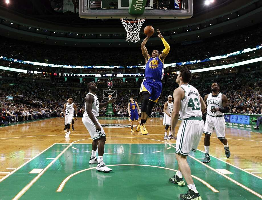 Andre Iguodala glides toward a dunk during the first half at TD Garden, and the Warriors built a 61-40 lead at halftime. Photo: Mark L. Baer, Reuters