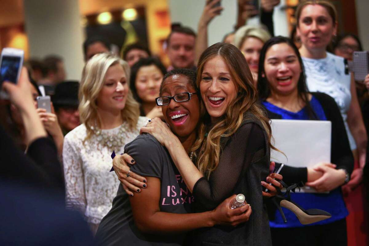Adina Sneed of Phoenix is hugged by actress Sarah Jessica Parker as Parker meets fans at the Seattle Nordstrom store on Wednesday. Sneed was first in line and had been waiting since 6 a.m. to meet Parker. The star of the hit show