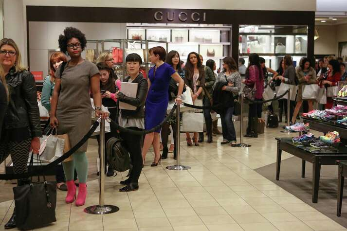People wait in line as actress Sarah Jessica Parker meets fans at the Seattle Nordstrom store.