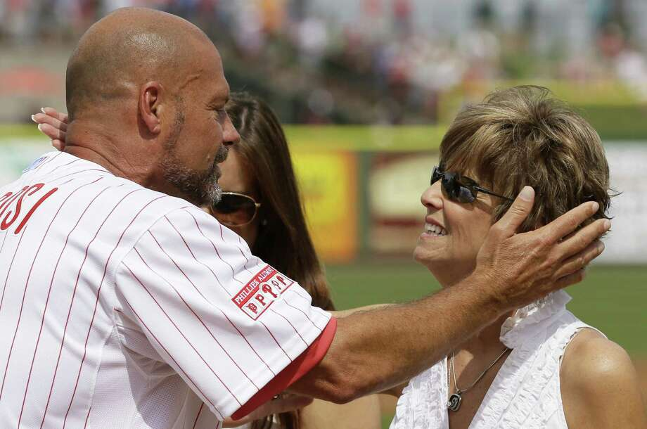 Ex-Phillies catcher Darren Daulton hugs Joni Fregosi, wife of ex-manager Jim Fregosi who died Feb. 14, in Clearwater, Fla. Photo: Charlie Neibergalll / Associated Press / AP