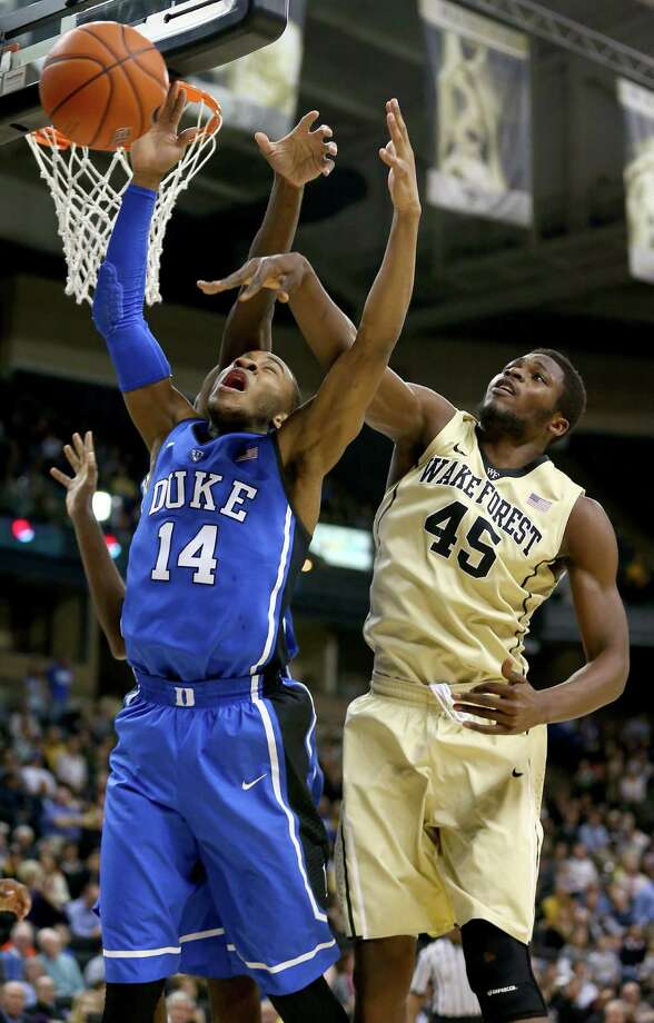 WINSTON-SALEM, NC - MARCH 05:  Arnaud-William Adala Moto #45 of the Wake Forest Demon Deacons tries to stop Rasheed Sulaimon #14 of the Duke Blue Devils during their game at Joel Coliseum on March 5, 2014 in Winston-Salem, North Carolina.  (Photo by Streeter Lecka/Getty Images) ORG XMIT: 456626943 Photo: Streeter Lecka / 2014 Getty Images
