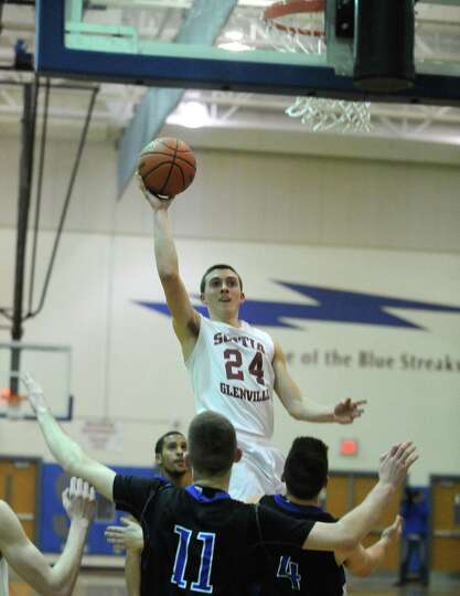 Scotia's Joe Cremo drives to the basket during their Class A boys' regional high school basketball g