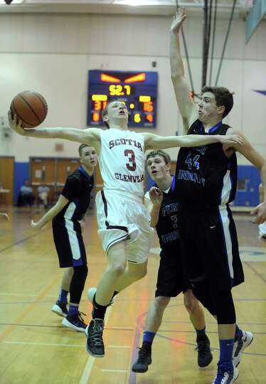 Scotia's Scott Stopera drives to the basket during their Class A boys' regional high school basketba