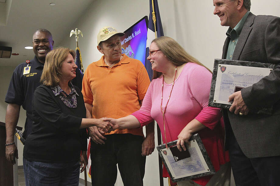 Jill and Mike Braun (from left) thank registered nurse Amber Myers and Dr. Dale Crockett for saving their lives after they and others were stricken with carbon monoxide gas poisoning. Photo: Tom Reel / San Antonio Express-News