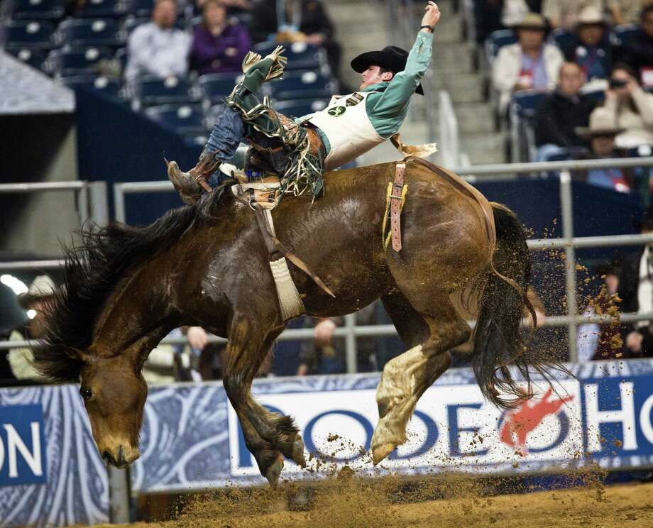 Richmond Champion, 21, of the Woodlands competes in Bareback Riding during the BP Super Series I Round 2 taking first place with 86 points at Reliant Stadium on Wednesday, March 5, 2014, in Houston. Photo: Marie D. De Jesús, Houston Chronicle / © 2014 Houston Chronicle