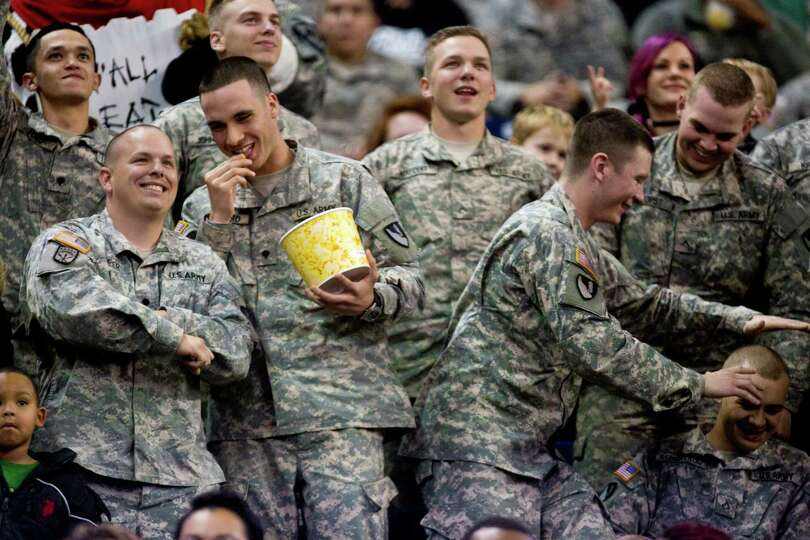 U.S Army soldiers share a good time at the Houston Livestock Show and Rodeo during Armed Forces Appr