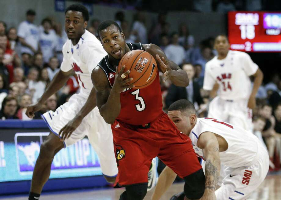 Chris Jones (center) and Louisville weathered a raucous sellout crowd to win 84-71 at SMU. Photo: John F. Rhodes / Associated Press / FR170608 AP