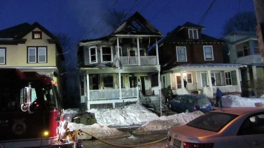 Albany firefighters battled a blaze at a Warren Street home Thursday that caused extensive damage to the home. The fire at 542 Warren St. was reported at 2:30 a.m. No one was injured. (Bob Gardinier / Times Union)