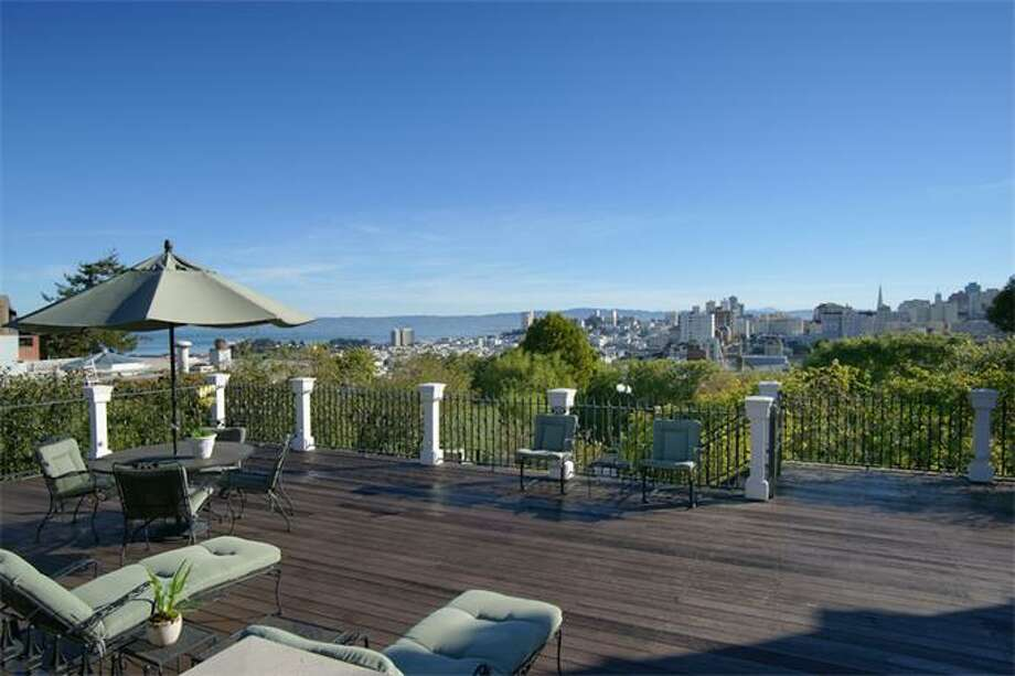 Currently the most expensive San Francisco house in the market, this 2724 Pacific Ave.mansion on Pacific Heights, worth $30 million, sports a spacious deck overlooking the entire city. (Photos via Christie's)