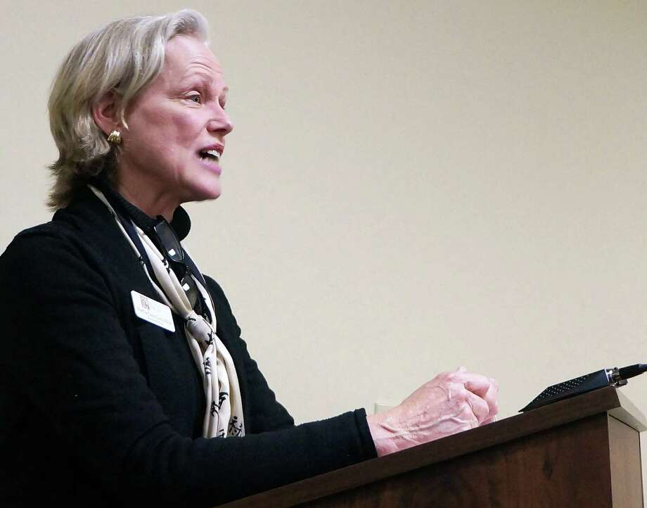 Pequot Library Executive Director Martha Lord asks the Board of Selectmen to reconsider the proposed $25,000 reduction -- to $325,000 -- in the town's 2014-15 budget. Photo: Genevieve Reilly / Fairfield Citizen