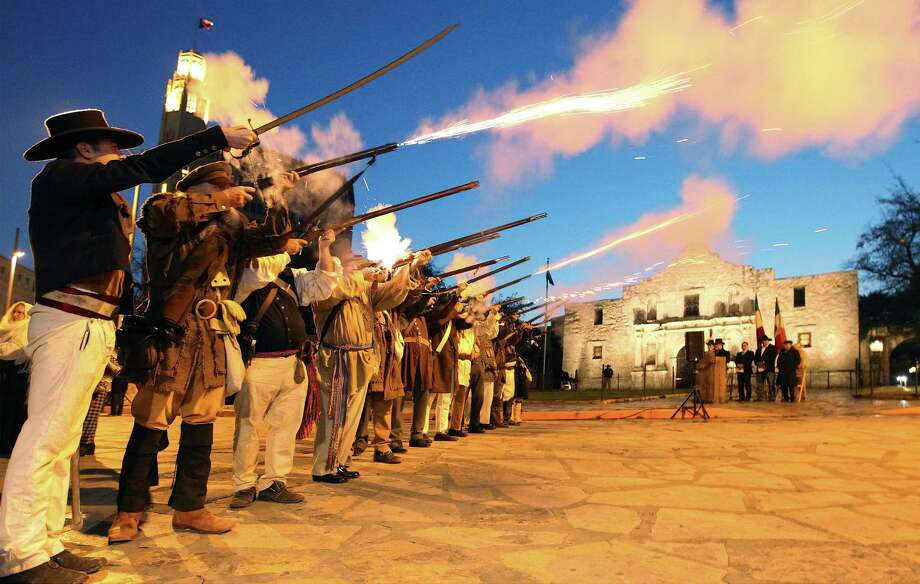 "Members of the San Antonio Living History Association fire muskets on Thursday, March 6, 2014 in front of the Alamo during the ""Dawn at the Alamo"" ceremony on the 178th anniversary of the battle for Texas independence. Hundreds of people gathered in the cold pre-dawn hours to witness the solemn remembrance that included a performance by a youth choir and a wreath laying ceremony. Photo: Kin Man Hui, San Antonio Express-News / ©2013 San Antonio Express-News"