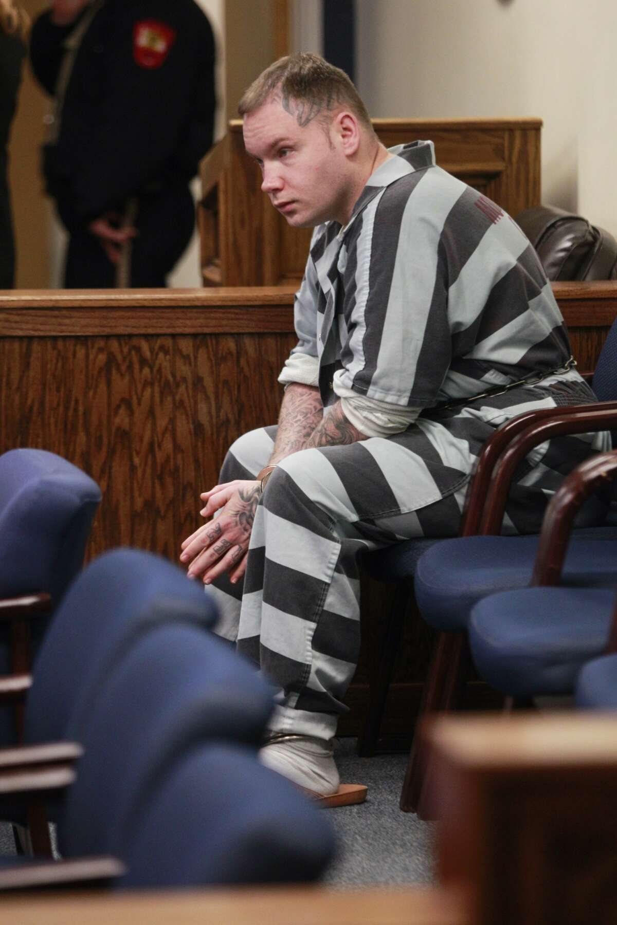 Donald Collins sits in the 359th State District Court on Thursday, March 6, 2014, in Conroe waiting to be transported after Judge Kathleen Hamilton ruled that he will be tried as an adult for allegedly setting 8-year-old Robert Middleton on fire with gasoline in 1998. Robert died in 2011.