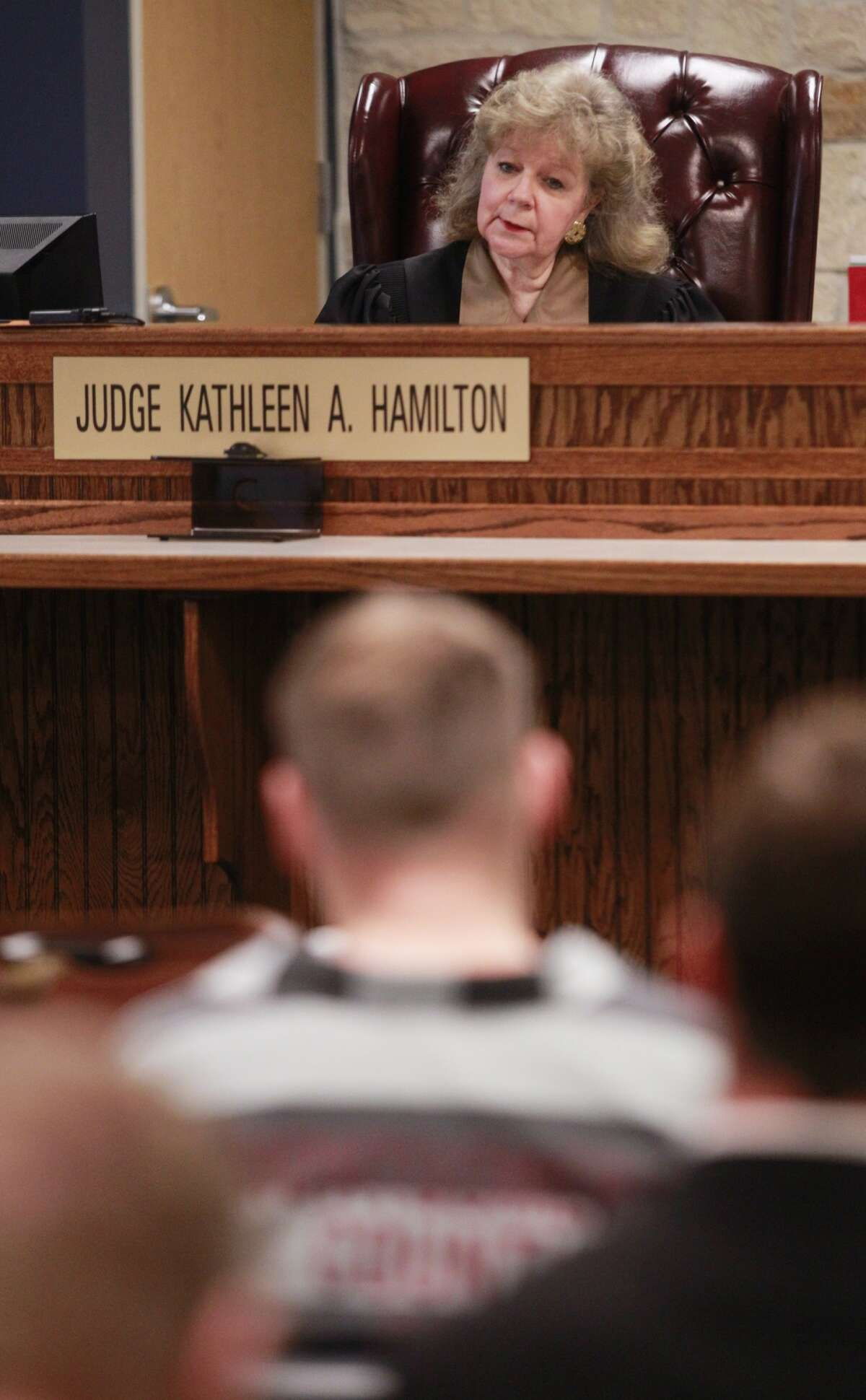 Donald Collins sits in the 359th State District Court on Thursday, March 6, 2014, in Conroe as Judge Kathleen Hamilton rules that he will be tried as an adult for allegedly setting 8-year-old Robert Middleton on fire with gasoline in 1998. Robert died in 2011.
