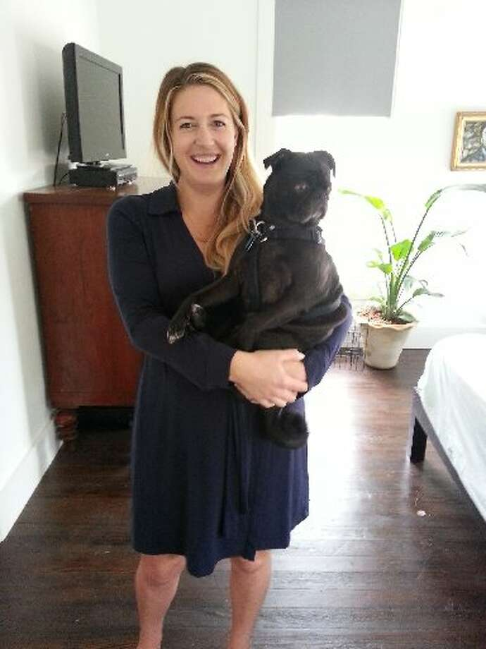 Kelly O'Connor and her pug, Gus, Photo: Emily Spicer, San Antonio Express-News