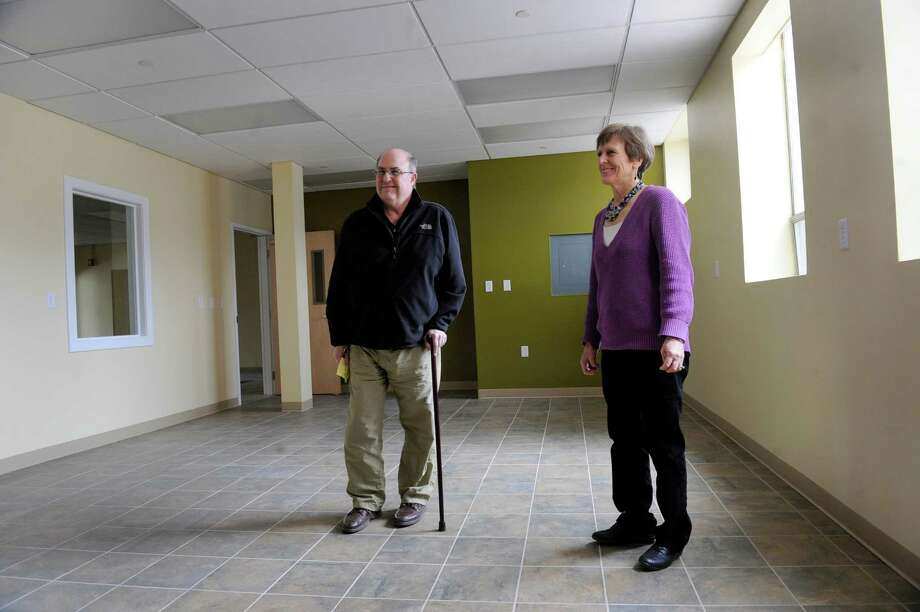 Dennis Daugherty, left, and Charlotte Cilley, both with SCORE, a group of retired business executives, walk around the new Danbury Innovation Center where the group will soon have an office, Wednesday, March 5, 2014. Photo: Carol Kaliff / The News-Times