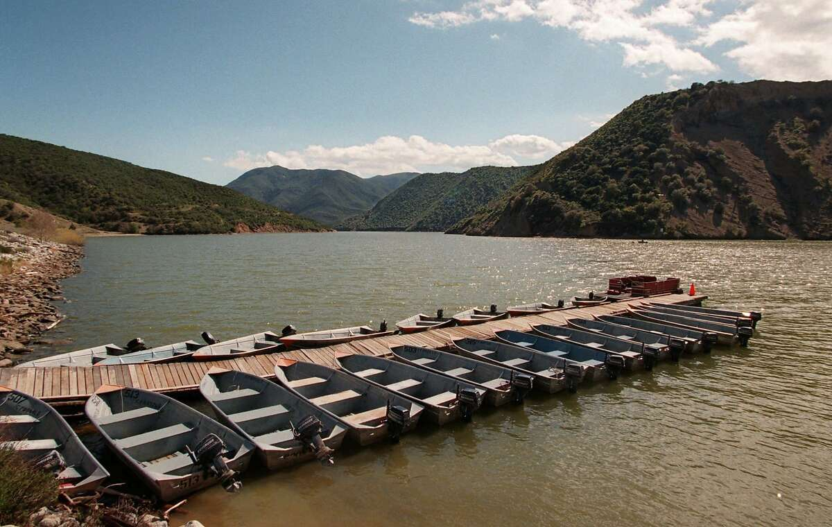 Rental fishing boats are secured to a dock in a nearly-full Pyramid Lake caused by El Nino in 1998.