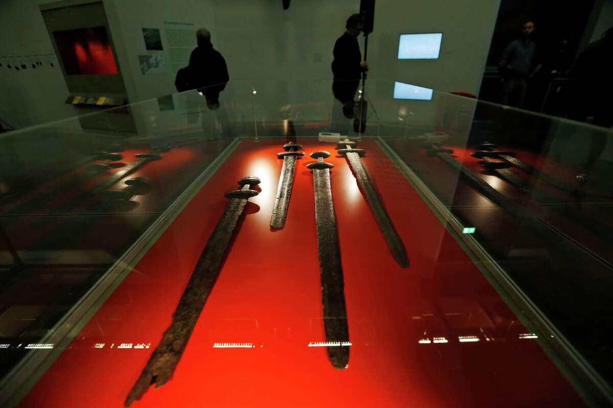 Viking swords are displayed part of a new exhibition entitled 'Vikings: Life and Legend' at the British Museum in central London, Tuesday, March 4, 2014. The new exhibition strives to make people think again about the Scandinavian pillagers who raided and struck terror into English villages. The exhibition aims to show how Viking energy and ideas re-drew the map of the world, through the presentation of their ships, their weapons, their crafts, their words and even their skeletons. (AP Photo/Lefteris Pitarakis) ORG XMIT: LLP108