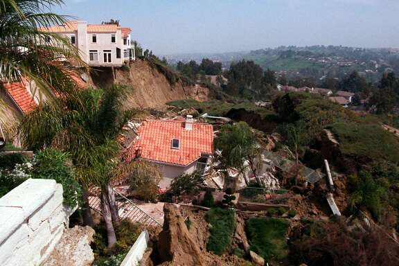 Two homes endangered by landslides from December's El Nino-driven storms broke loose from their foundations and slid towards a condiminium complex in Laguna Niguel, Calif., Thursday, March 19, 1998. The homes had been previously evacuated.