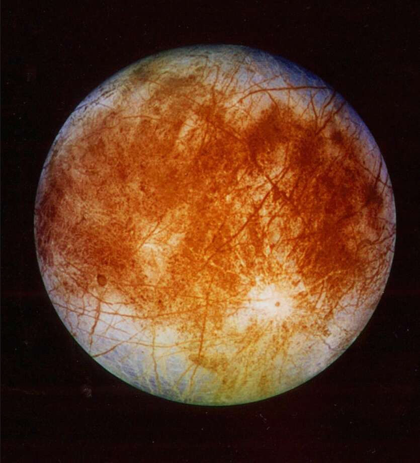 This image released by NASA's Jet Propulsion Laboratory in Pasadena, Calif. on Nov. 12, 1996 shows Jupiter's ice-covered moon, Europa, from the Galileo spacecraft. NASA said Tuesday, March 4, 2014 it is making preparations to plan a robotic mission to Jupiter's watery moon Europa, a place where astronomers speculate there might be life. The space agency set aside $15 million in its 2015 budget proposal to start planning a mission to Europa. No details were released but NASA chief financial officer Elizabeth Robinson said Tuesday that it would be launched in the mid-2020s. (AP Photo/NASA, Jet Propulsion Laboratory) Photo: Associated Press