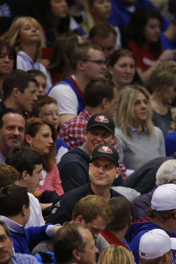 San Francisco 49ers coach Jim Harbaugh watches the second half of an NCAA college basketball game between Texas Tech and Kansas in Lawrence, Kan., Wednesday, March 5, 2014. Kansas defeated Texas Tech 82-57. Photo: Orlin Wagner, Associated Press