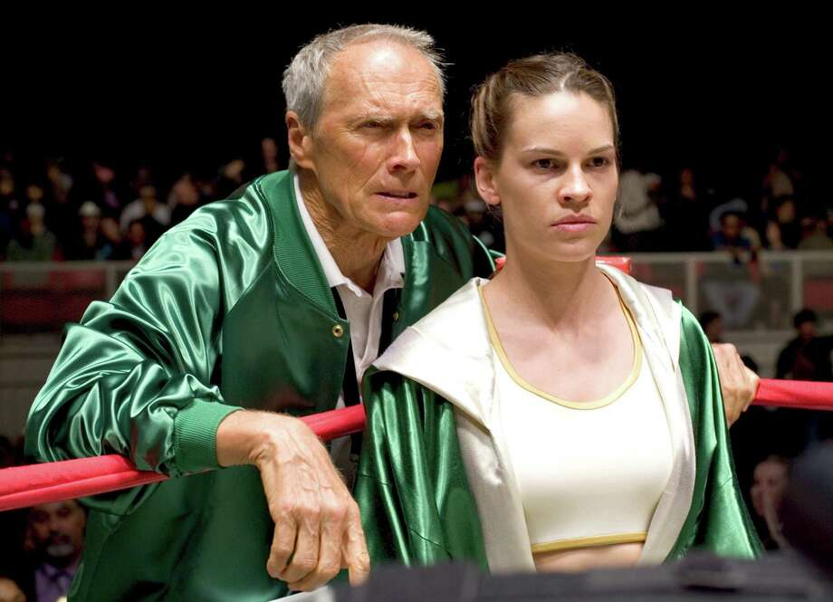 "This promotional photo provided by Warner Bros. Pictures shows actor-director Clint Eastwood, left, and actress Hilary Swank in a scene from ""Million Dollar Baby."" Clint Eastwood's boxing saga was nominated for best picture during nomination announcements for the 77th Oscars Tuesday, Jan. 25, 2005. Eastwood was nominated for best actor, while Swank was nominated for best actress. (AP Photo/Warner Bros., Merie W. Wallace) Photo: MERIE W WALLACE / WARNER BROS"