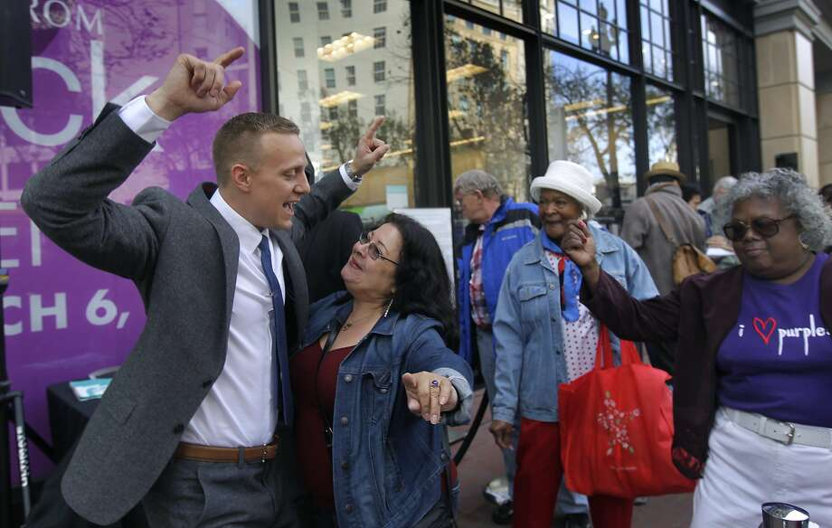 Dalila Quirarte, the first shopper in line at the new Nordstrom Rack, celebrates with store manager Mike Eubank. Photo: Paul Chinn, The Chronicle