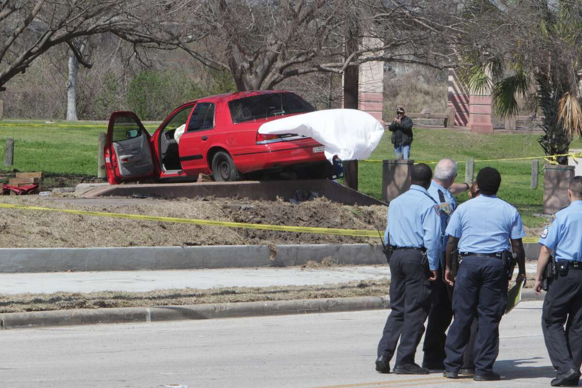 Officials investigate the scene of a fatal traffic accident, March 6, 2014. (James Nielsen / Houston Chronicle)