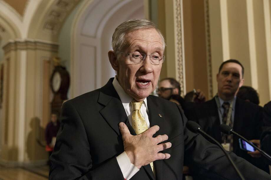 Senate Majority Leader Harry Reid, D-Nev., faces reporters at the Capitol after bipartisan Senate opposition blocked swift confirmation for President Barack Obama's choice to head the Justice Department's Civil Rights division, in Washington, Wednesday, March 5, 2014. The vote against advancing Debo Adegbile toward confirmation was 47-52, short of the majority needed under new procedures Democrats put in place earlier this year to overcome Republican stalling tactics. In this case, all 44 voting Republicans and eight Democrats lined up to block confirmation, leaving the nomination is grave jeopardy. (AP Photo/J. Scott Applewhite) Photo: J. Scott Applewhite, Associated Press