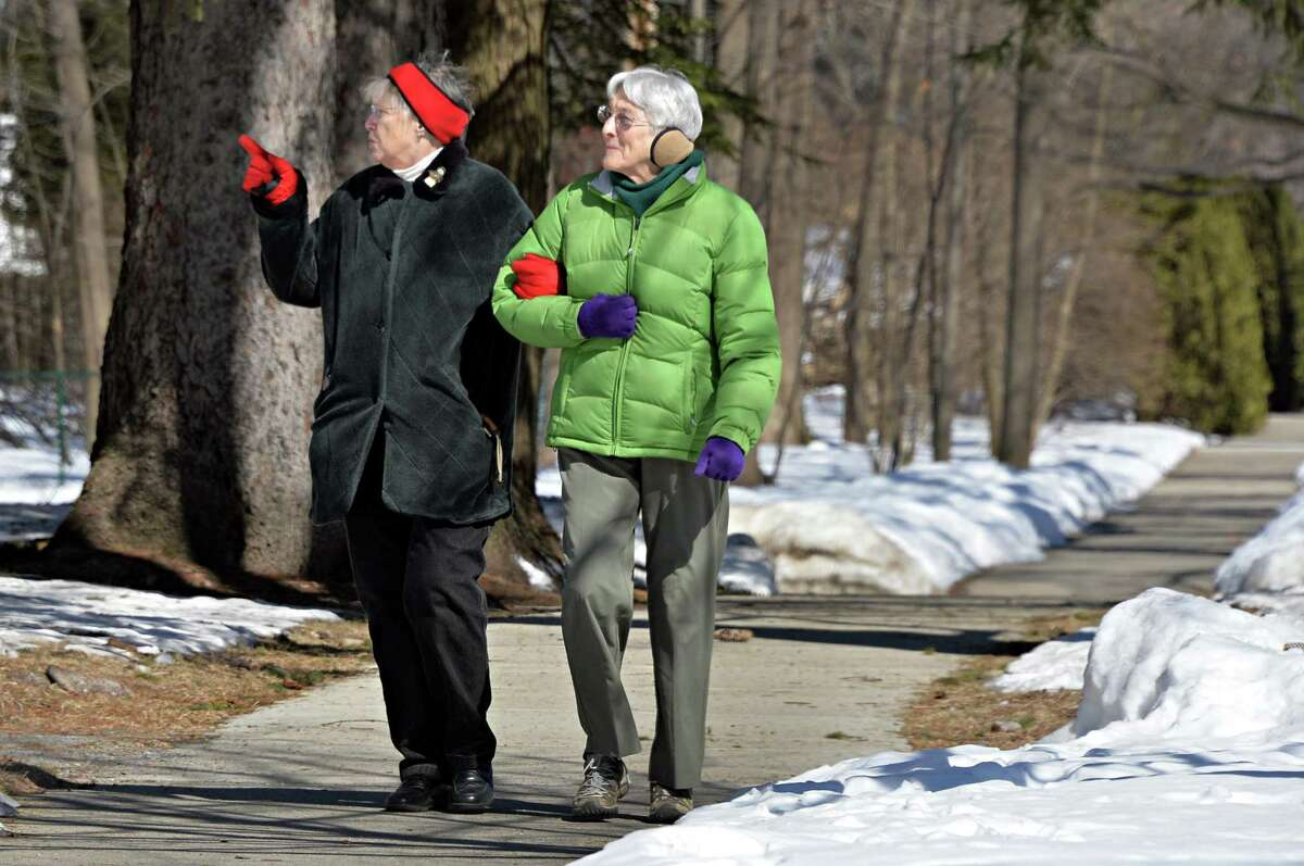 Samone Spaulding, left, of Wilton and Betty Chew of Ballston Spa enjoy a sunny morning stroll along North Broadway Thursday March 6, 2014, in Saratoga Springs, NY. Both are originally from Saratoga Springs and found much to reminisce about as they walked. (John Carl D'Annibale / Times Union)