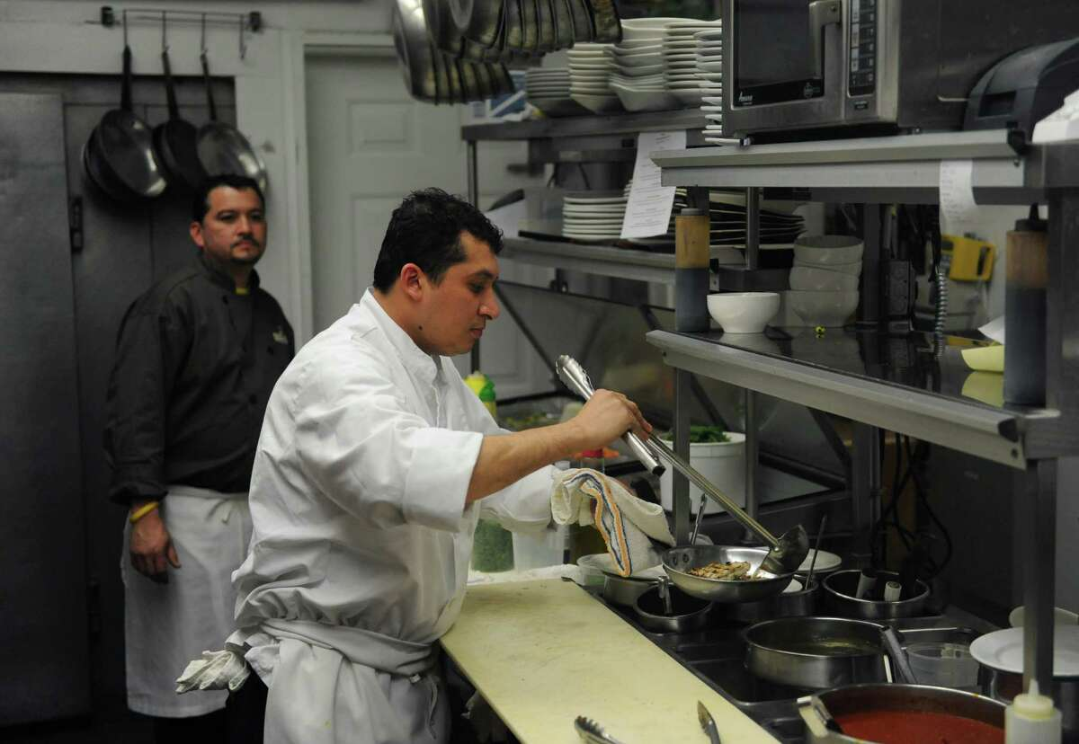 Chefs Carlos Pineda, left, and Jeison Aguirre prepare food in the kitchen at Sal e Pepe Contemporary Italian Bistro in Newtown, Conn. Tuesday, March 4, 2014. Sal e Pepe, Newtown Statewide and Fairfield County Michael's Trattoria, Wallingford Statewide Runner-up and New Haven County
