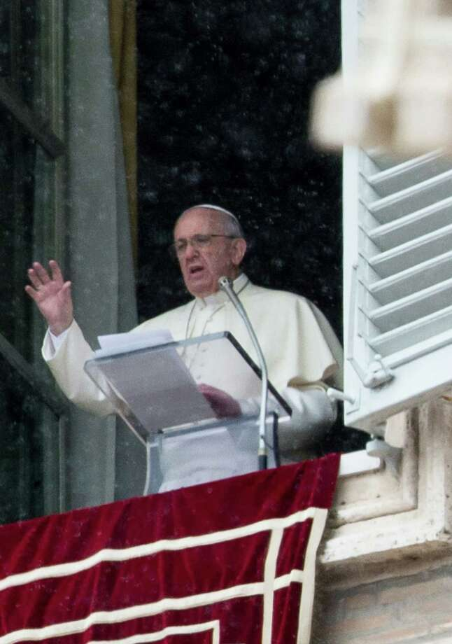 Pope Francis, shown speaking from his apartment in St. Peter's square on March 2, sought a worldwide survey of Catholics on social issues. The results are in, and they show widespread schisms from church doctrine. Photo: Andreas Solaro / Getty Images / AFP