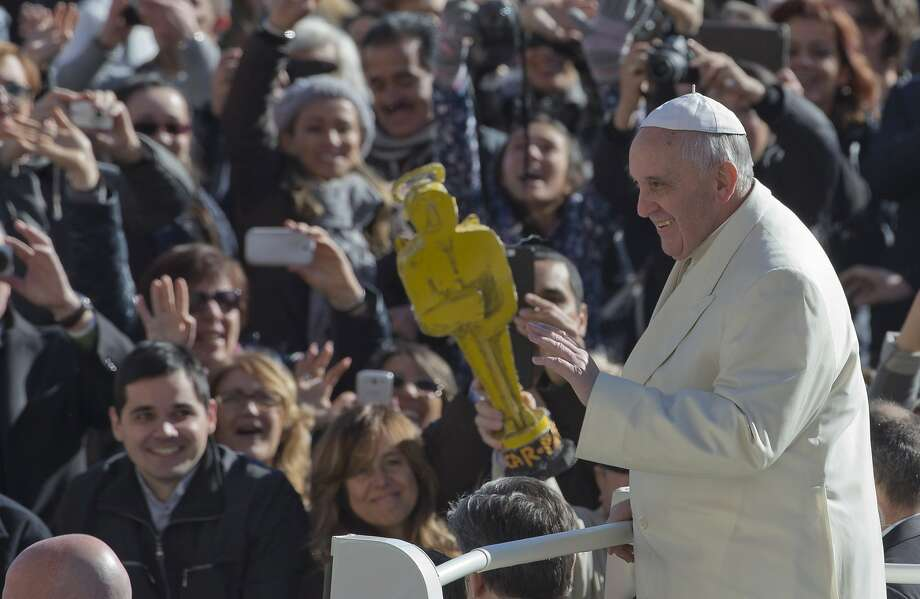 "I'd like to thank my family - Father, Son and Holy Ghost:In St. Peter's Square at the Vatican, a member of Pope Francis' flock awards him ""an Oscar."" Photo: Alessandra Tarantino, Associated Press"