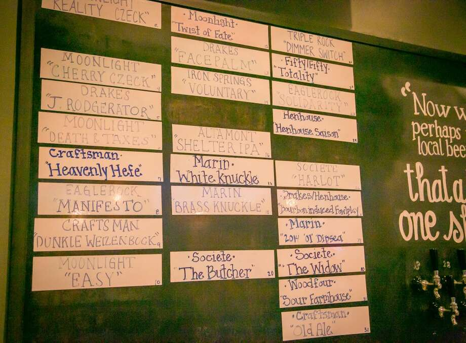 The list of beer on the wall at Hog's Apothecary in Oakland. Photo: John Storey, Special To The Chronicle