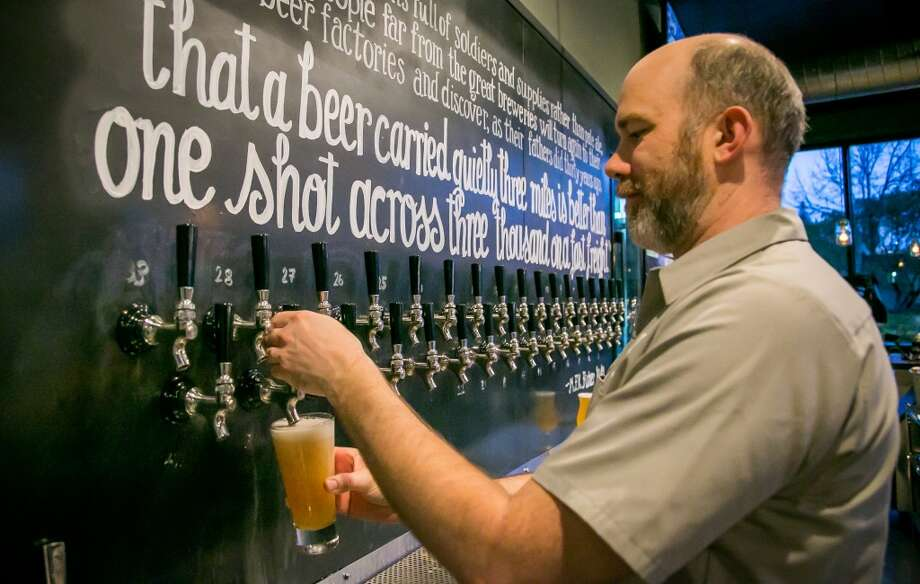 John Hill pours a beer at Hog's Apothecary in Oakland. Photo: John Storey, Special To The Chronicle