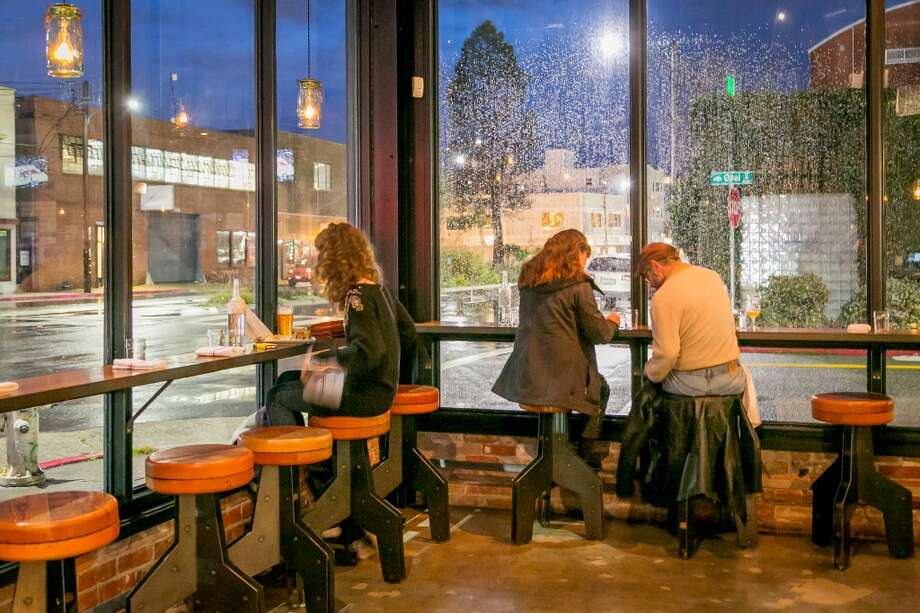 Diners enjoy dinner at Hog's Apothecary in Oakland. Photo: John Storey, Special To The Chronicle