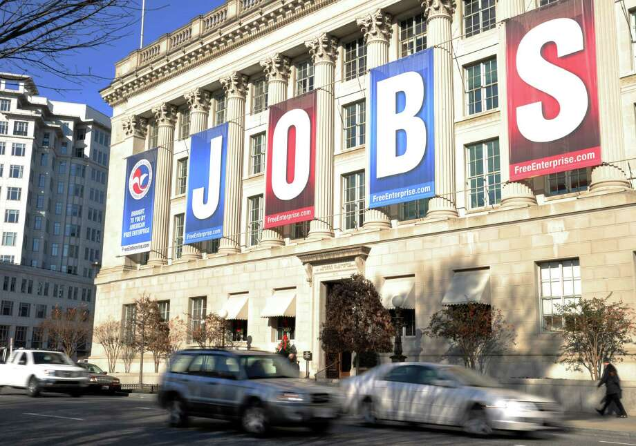 A jobs sign hangs above the entrance to the US Chamber of Commerce building in Washington, D.C. The nation's capital came first in a list of cities with the most entry level jobs. Photo: KAREN BLEIER, Staff / AFP ImageForum