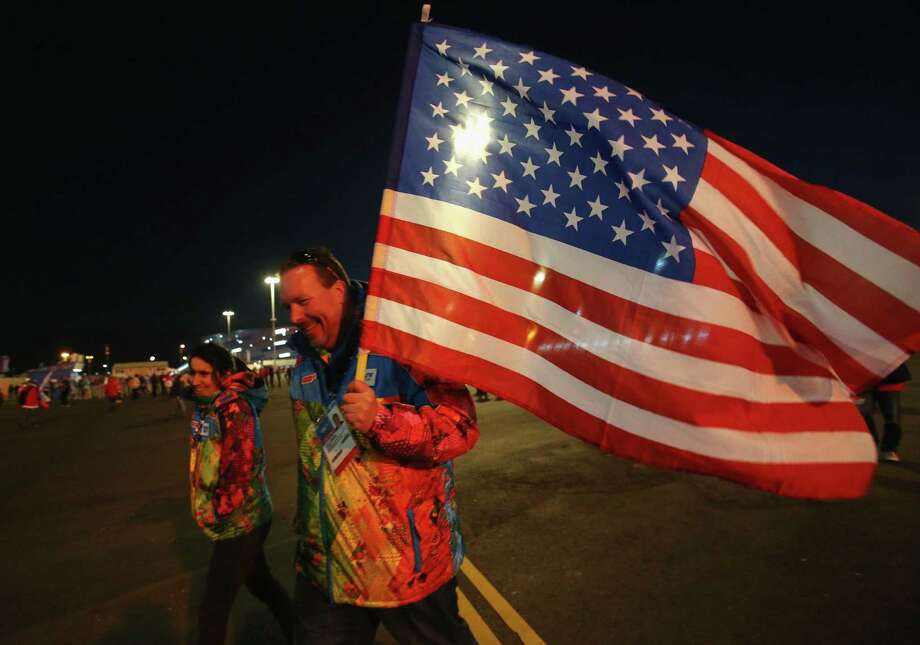 A U.S. sports fan carries an American flag during the recent Winter Olympics in Sochi. A reader thanks a previous letter writer for expressing his love for  the flag and the country it represents. Photo: Bruce Bennett / Getty Images / 2014 Getty Images