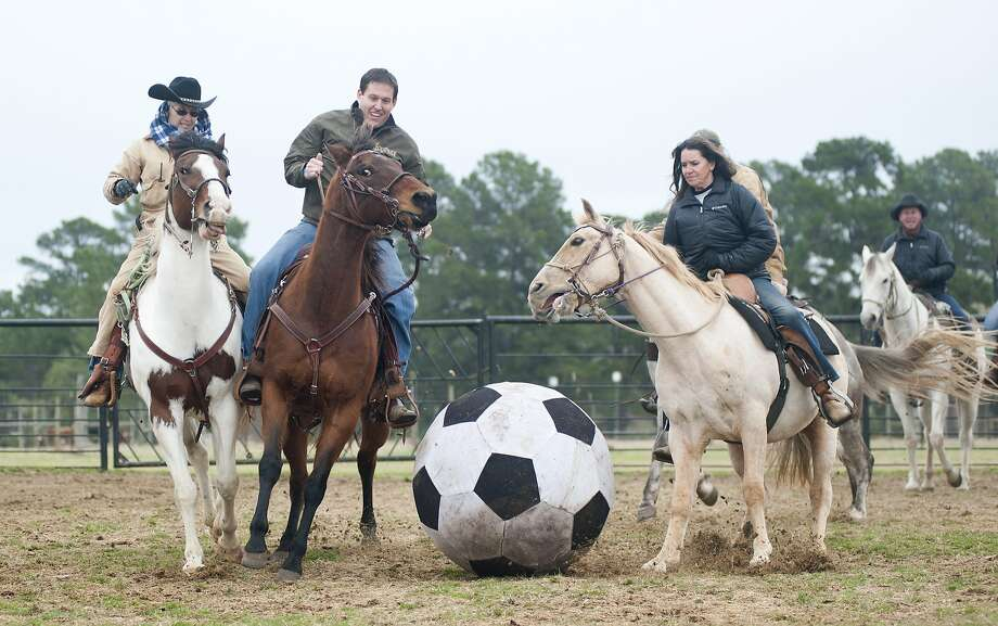 The next best thing to Afghan goat carcass polo:The 1836 Chuckwagon Race Festival in Neche, Texas, also features mounted soccer. The horses don't kick the ball as much as run into it. Photo: Sarah A. Miller, Associated Press