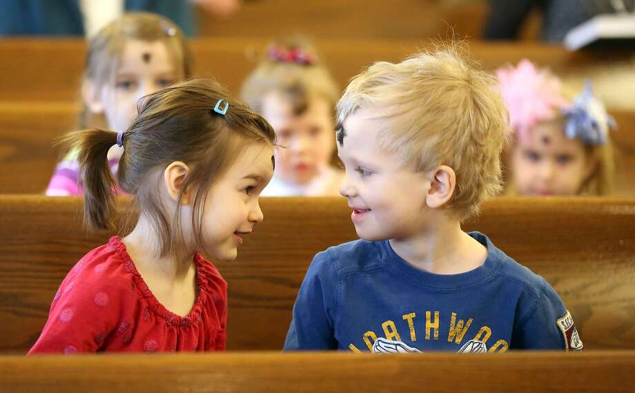 When do we all fall down?Claire Mier, 4, and Ben Helle, 3, compare ashes during an Ash Wednesday Mass at Resurrection Church in Dubuque, Iowa. Photo: Jessica Reilly, Associated Press