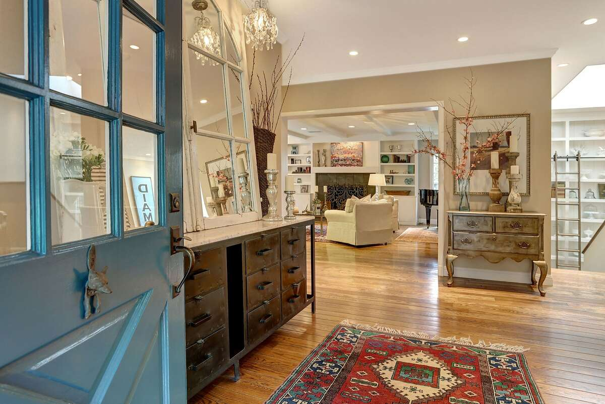 The entry leads to the public rooms and showcases the luxury finishes and subtle build-ins of the Piedmont home.