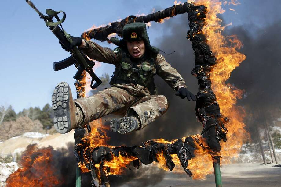 I don't always wear asbestos underwear, but when I do ...A soldier jumps through a ring of fire during a tactical training mission in Heihe, northeast China's Heilongjiang province. Photo: Stringer, AFP/Getty Images