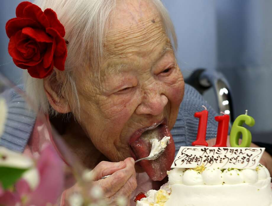 Born in the 19th century:In a nursing home in Osaka, Japan, Misao Okawa eats her cake at her birthday party. Misao, the oldest woman in Japan, turned 116 Wednesday. Photo: Buddhika Weerasinghe, Getty Images