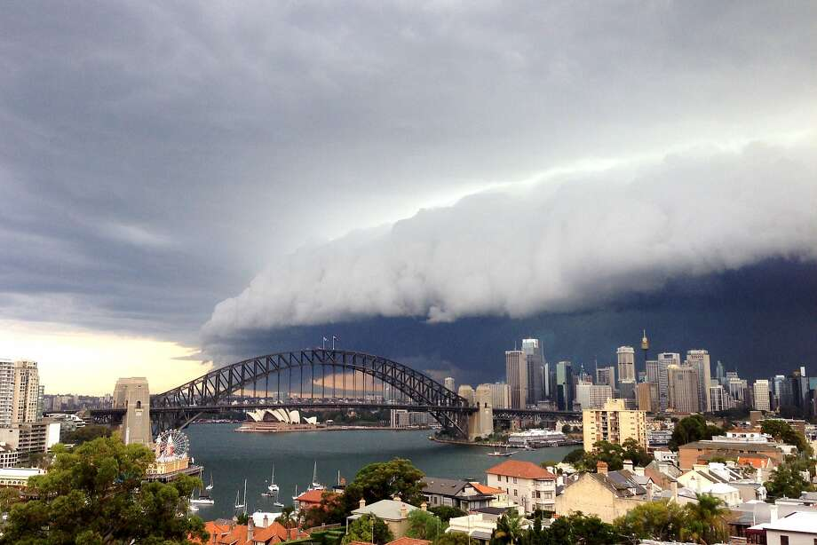 A foreboding storm cloud rolls in to Sydney in this image taken with smartphone. Severe thunderstorm and flash flood warnings were issued for the  metropolitan area. Photo: Cassie Trotter, Getty Images